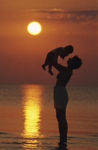 bigstock-mother-and-baby-at-beach-sunse-12114032